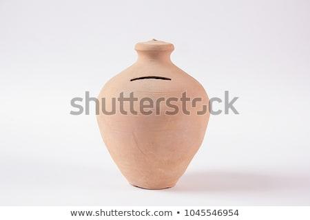 pots of clay with coins stock photo © marinini