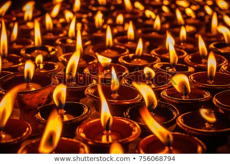 oil lamp with light in buddha temple stock photo © zmkstudio