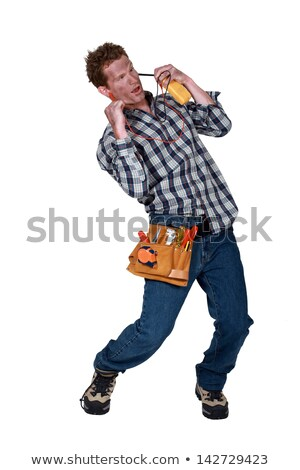 A dazed electrician suffering from electric shock Stock photo © photography33