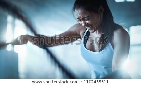 edzés · nővér · mér · bicepsz · jóképű · férfi · épület - stock fotó © stokkete