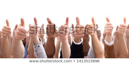 Thumbs up close up on black background Stock photo © Maridav