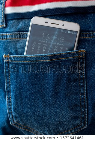 cell phone in back pocket stock photo © dukibu