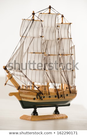 wooden ship toy model on white table against white background stock photo © hasloo