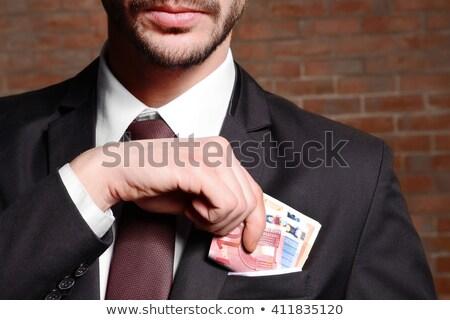 férfi · öltöny · Euro · számlák · ül · asztal - stock fotó © nito