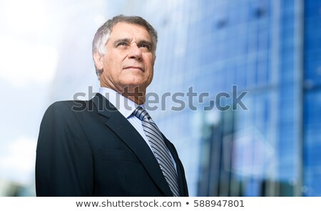 Handsome experienced businessman Stock photo © stockyimages