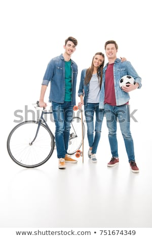 Beautiful young girl with longboard and bicycle standing on the  Stock photo © vlad_star