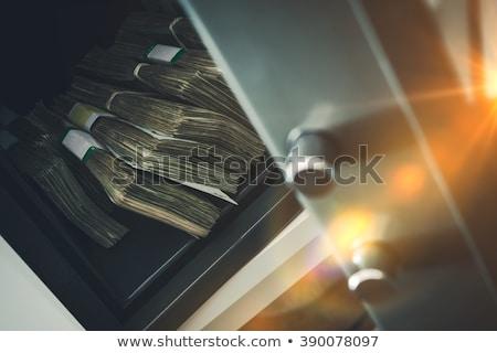 Stock photo: cash on safe