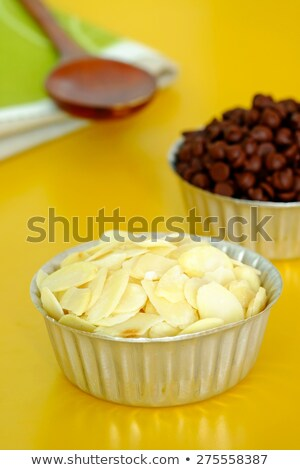 Bakery raw sliced  almonds in measured cup  Stock photo © nalinratphi