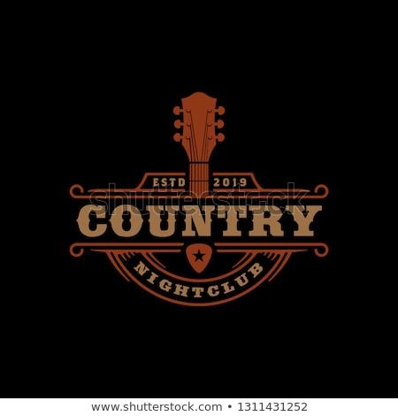 Zachodniej kraju cowboy muzyk gitara czarno białe Zdjęcia stock © stevanovicigor