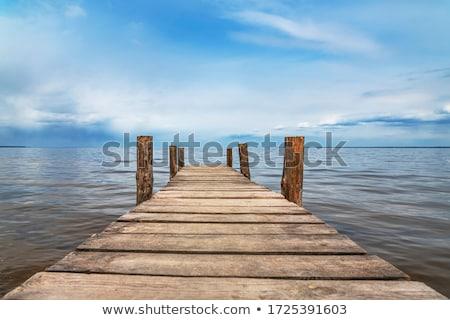 Ponte lago paisagem céu cidade pôr do sol Foto stock © lukchai