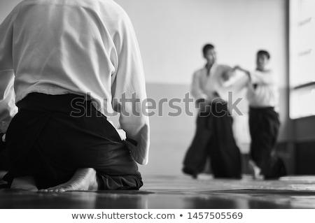 Aikido leraar poseren geïsoleerd witte vrouw Stockfoto © hsfelix