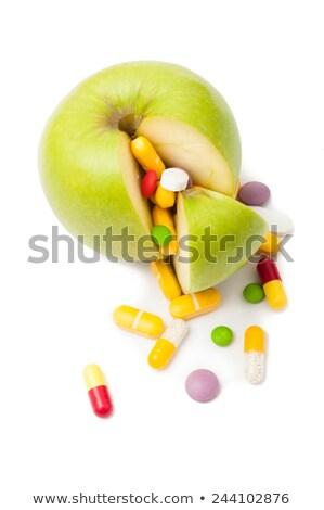 Verde mela colorato pillole bianco Foto d'archivio © ironstealth