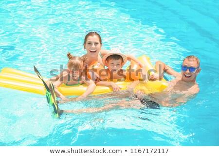 mulher · ar · colchão · piscina · retrato - foto stock © deandrobot