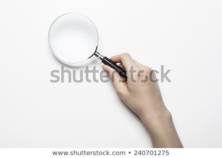 Vergrootglas glas vrouw hand geïsoleerd witte Stockfoto © tetkoren