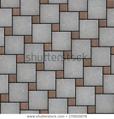 Concrete Brown Figured Pavement of Large and Small Squares. Stock photo © tashatuvango