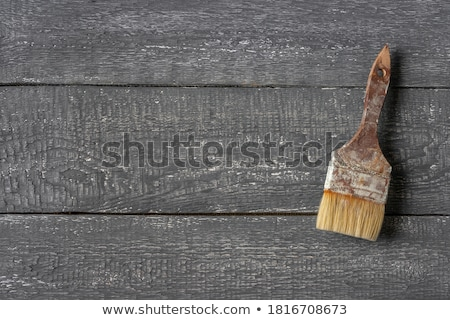 Old used paintbrush on rustic wooden board Stock photo © stevanovicigor