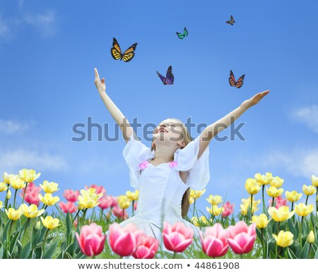 little girl in tulips with hands up and butterfly collage stock photo © paha_l