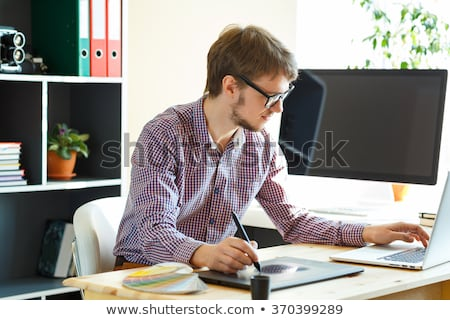 Artist drawing something on graphic tablet at the home office stock photo © vlad_star