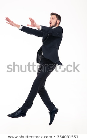 Stunned afraid businessman flying with strong wind blowing on him  Stock photo © deandrobot