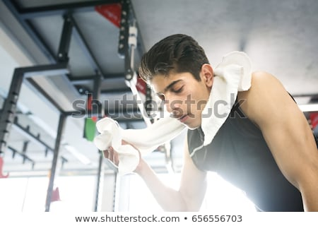 Young Bodybuilder wiping his face with his shirt Stock photo © wavebreak_media