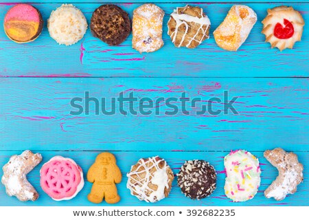 Assortment of colorful cookies on blue wood Stock photo © ozgur