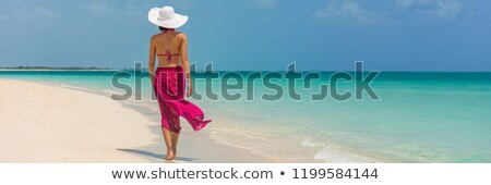 carefree bikini woman relaxing in beach pareo stock photo © maridav