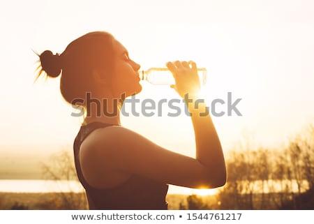 Oefening drinken water fitness sport oranje Stockfoto © blasbike