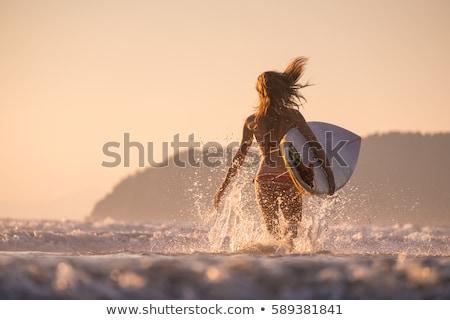 Kız sörf plaj gün batımı örnek kadın Stok fotoğraf © adrenalina