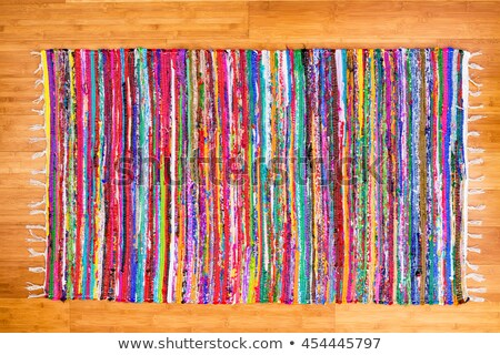 Close up colorful hand woven rug on bamboo floor Stock photo © ozgur