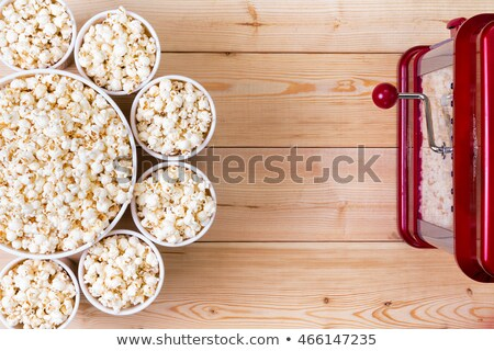 Bowls of fresh popcorn alongside a machine Stock photo © ozgur