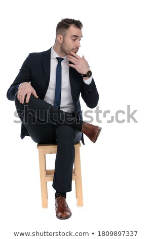 seated young businessman dreaming away with hands crossed Stock photo © feedough