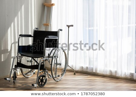 Stock photo: Crutches and Wheelchairs