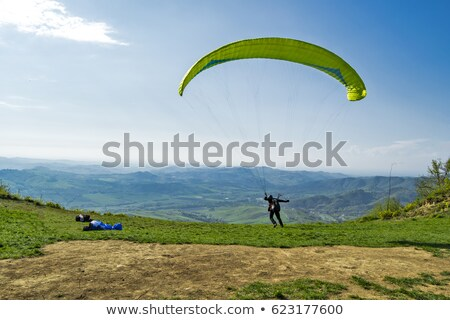 paraglider taking off from a mountain stock photo © zurijeta