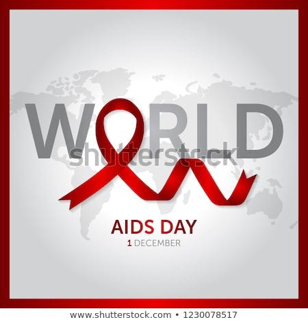 Világ AIDS nap tudatosság vörös szalag földgömb Stock fotó © Said