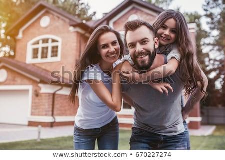 счастливым пару дома марионеточного продажи ключами Сток-фото © compuinfoto