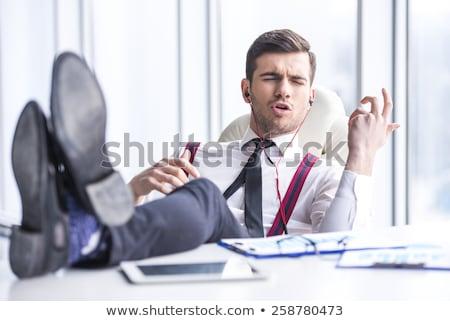 vetor · homem · ouvir · música · fones · de · ouvido · escritório · feliz - foto stock © rastudio