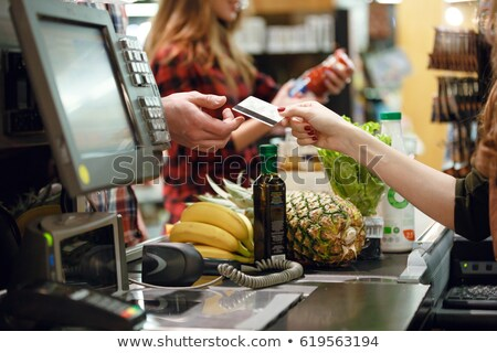 Cashier lady on workspace in supermarket shop Stock photo © deandrobot