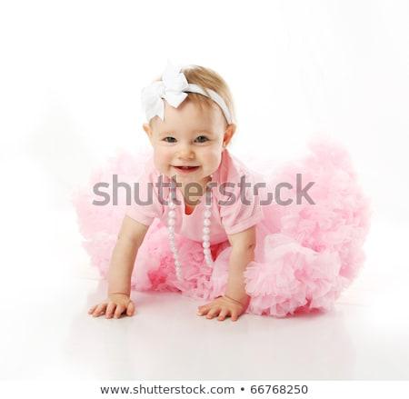 smiling little girl wearing pink headband sitting stock photo © feedough