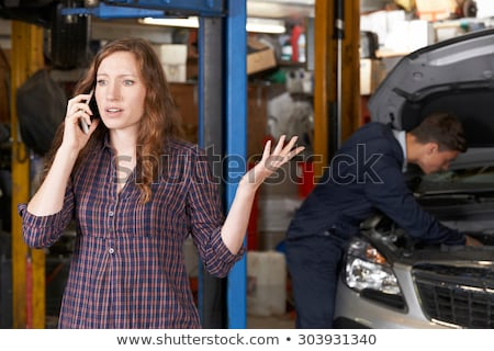unhappy frustrated female calling car mechanic repair shop stock photo © stevanovicigor
