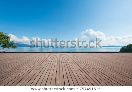 Beautiful daylight view to blue sea, green mountains and beachli Stock photo © frimufilms