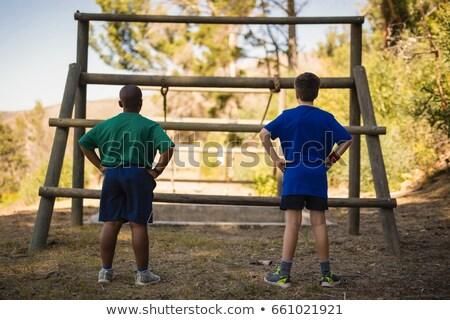 Vue arrière garçon regarder extérieur équipement Photo stock © wavebreak_media