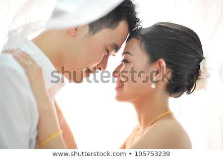 affectionate bride and groom kissing on their wedding day stock photo © wavebreak_media