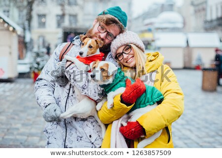 Woman in warm clothes playing with dog  Stock photo © dariazu