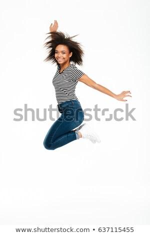 boldog · aranyos · afroamerikai · fiatal · nő · ugrik · levegő - stock fotó © deandrobot