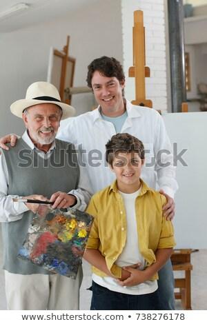улыбаясь · человека · Живопись · привлекательный · белый · стены - Сток-фото © is2