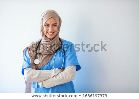 muslim woman in hijab over white background Stock photo © dolgachov