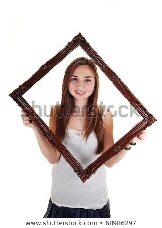 довольно девушки рубашку длинные волосы изолированный Сток-фото © Traimak