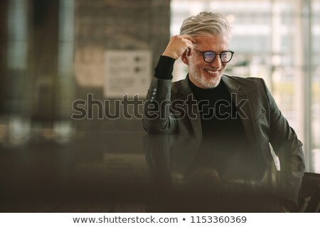 senior businessman relaxing in cafe stock photo © is2