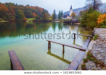 raining on bohinj lake stock photo © stevanovicigor