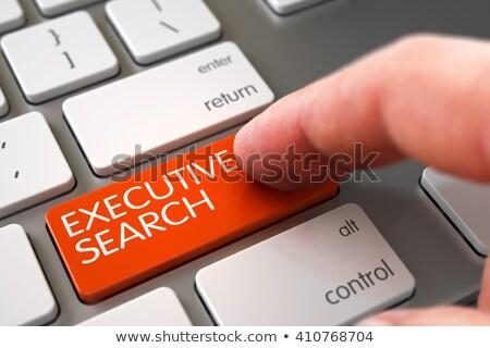 Hand Touching Executive Search Keypad. Stock photo © tashatuvango